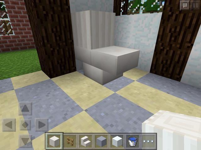Ahora, en el mismo color que sus bloques de escaleras, coloque un bloque en la parte superior. Esta es la parte de atrás de la taza del baño.