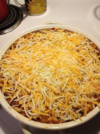 Cubrir con el queso y cubrir con papel de aluminio. Poner en un horno a 400 grados durante 30 minutos.