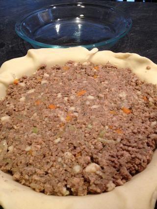 Una vez fría añadir la mezcla de salsa de carne seca y mezclar bien Empaque en el molde de tarta sin hornear. El relleno tiene que ser fácil de transportar y no tienen ningún líquido. la mezcla de salsa actúa como un aglutinante para el llenado .Makes 2 pasteles.
