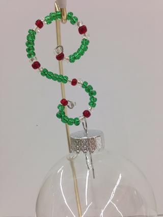 Eso's how easy it is to make a Sparkly S-Shaped Ornament Hanger! It will look beautiful holding a very special decoration on your tree.