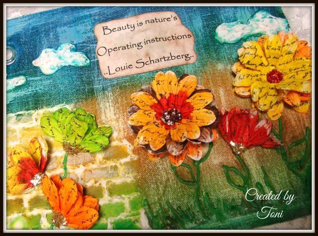 Pegue su sentimiento y utilizar la pistola de pegamento caliente para aplicar sus flores bonitas. Me seco rocé las flores un poco de pintura acrílica blanca para mayor textura e interés.