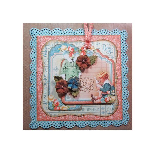 Agregue el equipo al frente de la tarjeta con un cuadrado de espuma y luego agrupar algunas flores Petaloo de todo el equipo y la cola hacia abajo.