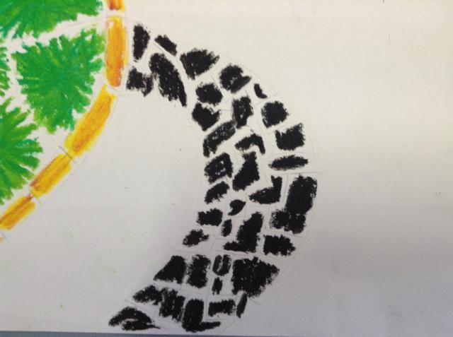 Color en todas las aletas, la cola y la cabeza con el pastel del aceite negro.