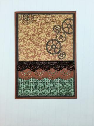 Adherirse naranja pieza de cartulina frontera perforado y encaje negro a través de la tarjeta como se muestra.