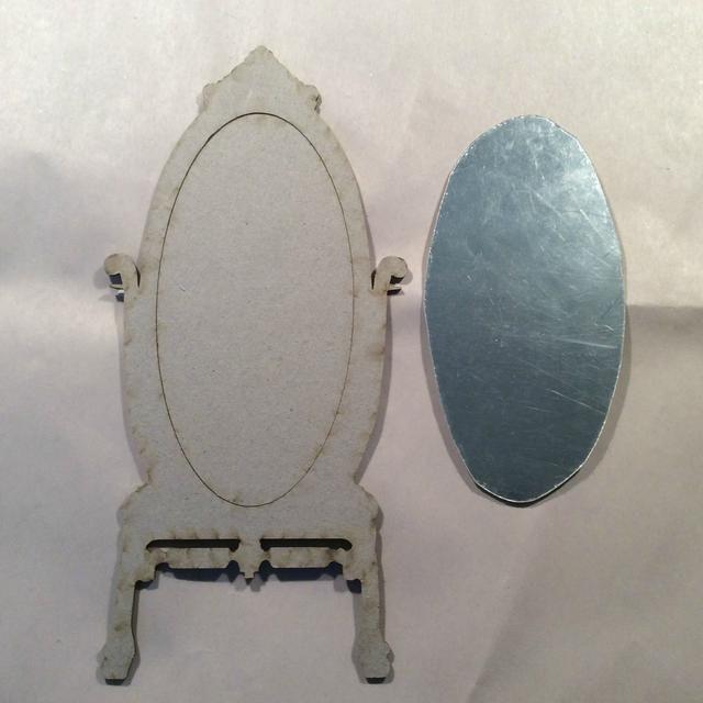 Cortar mi hoja de espejo para encajar el interior de mi espejo baja y dejar de lado.