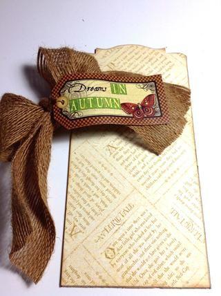 Ate un pedazo de cinta en un arco con un sentimiento como la etiqueta deseada y adherirse a papel con pegamento pegajoso.