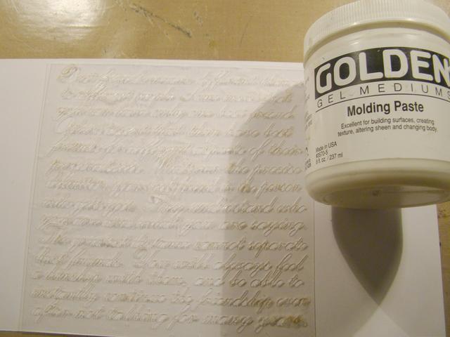 Aplicar la plantilla de la escritura a la lona usando tu Molding Paste. Deje que se seque por completo.