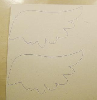 Encontré un ala en el Internet y los saqué de aglomerado luego recortarlas.