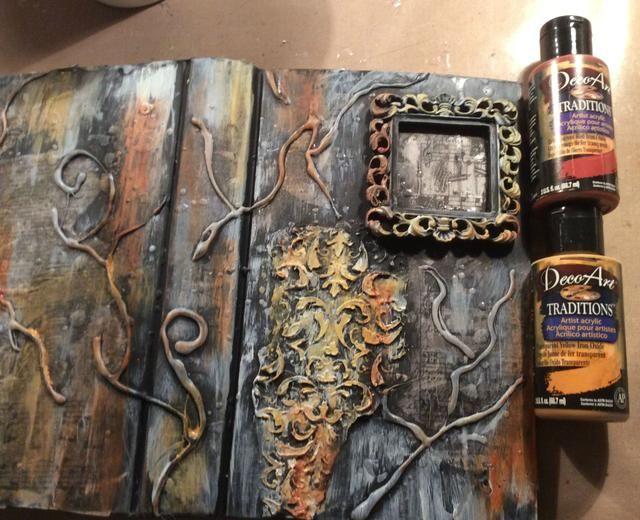 El uso de acrílicos y mi dedo excelente práctico me unté pintura aquí y allá sobre el lienzo y el marco. Deje que se seque.