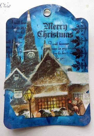 Recorta algunos gráficos de la colección G45 Cuento de Navidad y pegarlas en la etiqueta.
