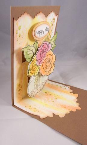 Sello y morir cortó el sentimiento y se adhieren a la parte superior de la tarjeta. Adherirse al panel pintado a la base de la tarjeta.