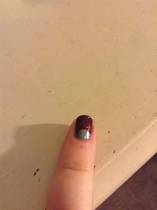 si tu're using a sticker you just have to paint your nail. If you did it freehand, fill in either the circle, or the rest of your nail. If you want, you can find my guide on doing Half Moon nails.