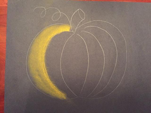 Mezclar la naranja a la izquierda usando su tejido. Deja un poco de negro a la izquierda.