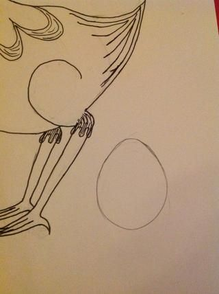 En lápiz, dibujar un huevo grande detrás de él