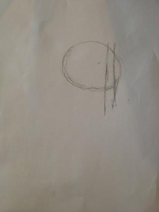 Dibuja dos líneas más en el interior del círculo, esta será la base para dibujar los ojos en