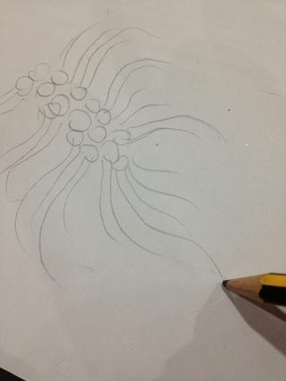 Comience con esbozar el diseño en una hoja de papel