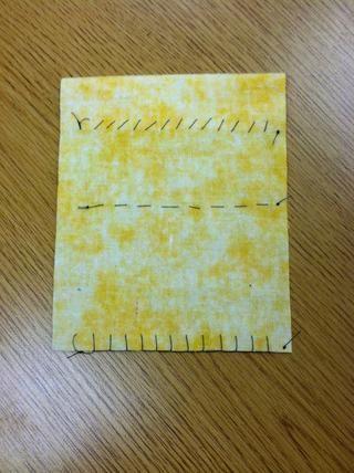 Terminado Volver: Asegúrese de que tiene un nudo en el principio y final de cada puntada y que esos nudos aparecen en la parte posterior. Asegúrese de que todos los hilos sueltos se recortan.