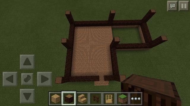 Siguiente utilizando bloques de abeto de nuevo, he esbozado las partes exteriores de la forma. Coloque bloques en la parte superior de la tabla de madera. Recuerda dejar un agujero a una cuadra alrededor de las escaleras para que la puerta!
