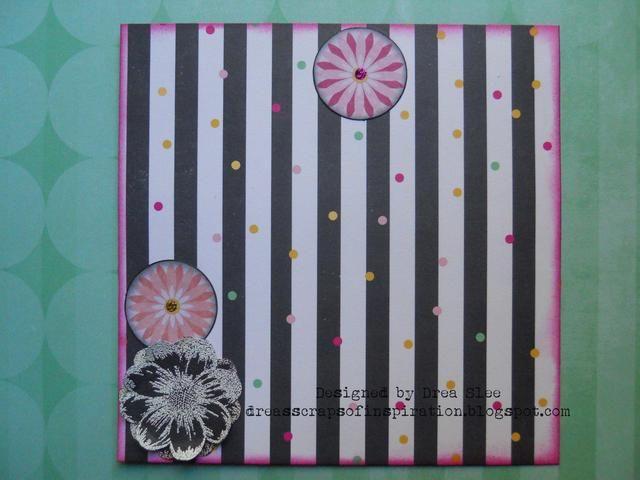Bordes de tinta de tres de las flores en forma de círculo que vienen en el paquete de destacar con hollín Negro Tinta Distress. Añadir un punto de Stickles a los centros, y poner uno a un lado.
