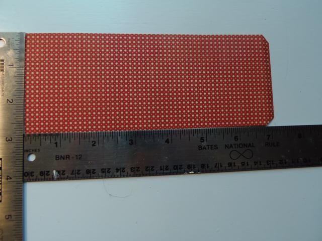 Corte un pedazo de coordinación de cartulina que mide 2 3/4