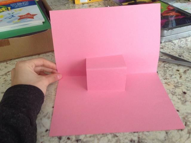 Abra la tarjeta y lo que queda es un cuadro emergente en el medio :)