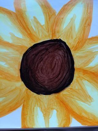 Mezcla en con el marcador marrón usando grandes movimientos circulares
