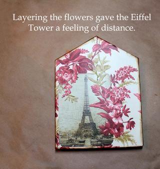 Entonces ellos en capas sobre la torre Eiffel para crear distancia.