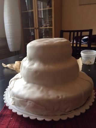 Coloque la pasta de azúcar del pastel.