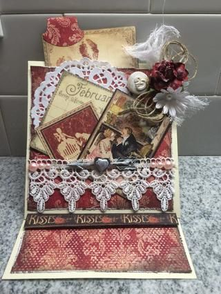 Por último, he decorado la tarjeta mediante la adición de un tapete, encajes, gasa, hilo, botones, ebellishments y Gráfico 45 Place in Time (febrero) de papel de tarjetas. Se puede ver que hice una ficha y se añade a la etiqueta retirada.
