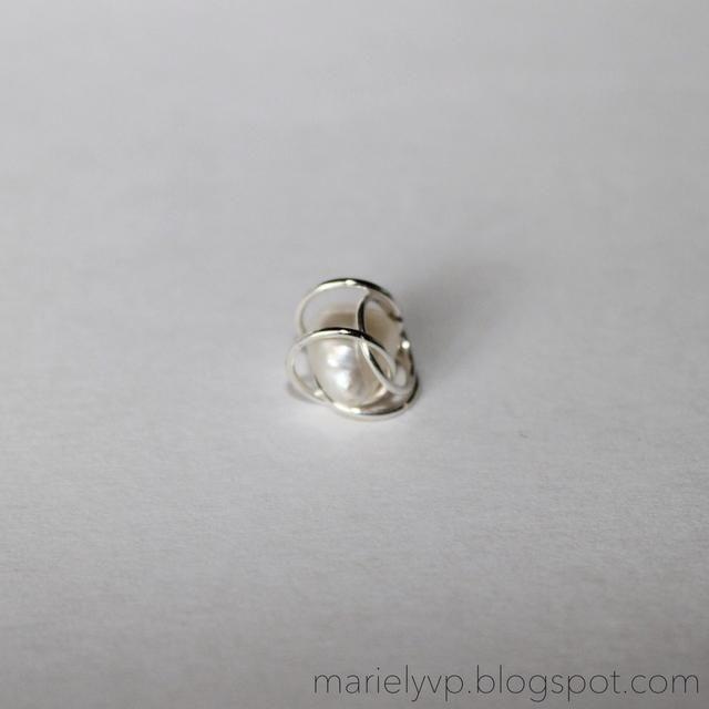 Paso 5: mover los otros dos anillos de salto más cerca para mantener a la perla del todo dentro.