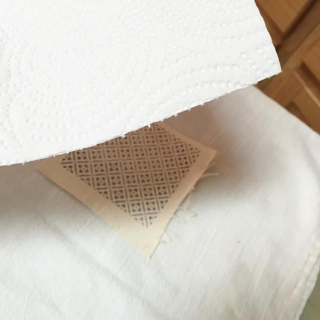 Crafter's Inks are permanent on fabrics when they are heat set. cover ironing board with cloth or paper towels, place stamped fabric piece on it and cover with a white paper towel.