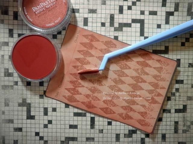 Use una esponja Softt añadir Pan Pasteles a toda la hoja estampada. Interesante cómo los arlequines estampadas recogieron el color de los Pasteles Pan para convertirse en un nuevo color.