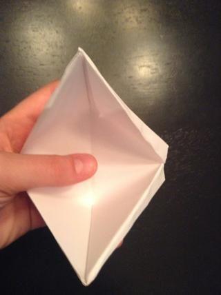 Por último, abra las entrañas y doblar la parte superior e inferior juntos
