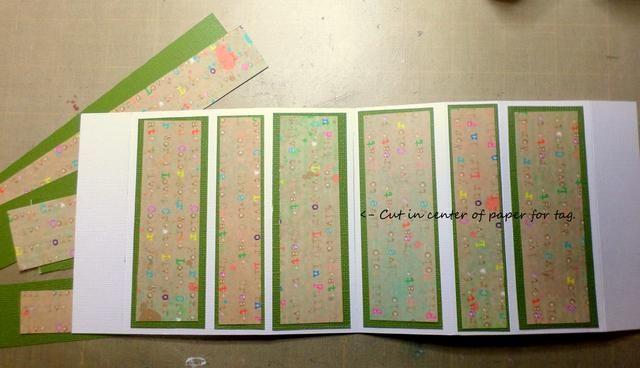 Cortar una hendidura en el centro de la cartulina para la etiqueta a pasar a través. Decora tus tiras como desee. Corté cartulina verde y papel con diseño de Susan K. Weckesser.