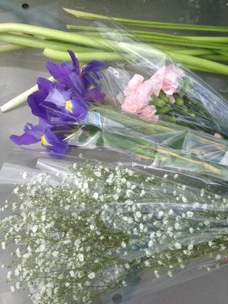 Dejar's add some iris, baby breath and pink carnations from the grocery store ($12)