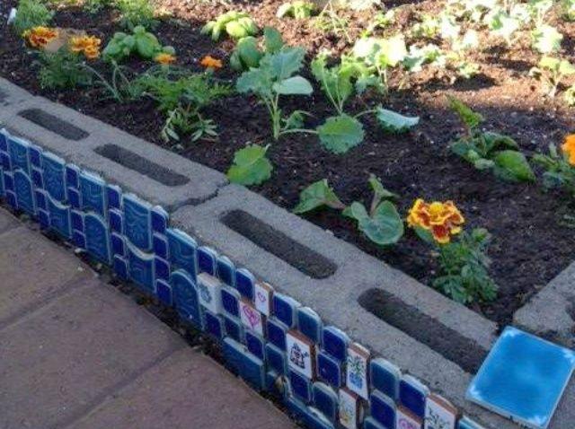 Cómo hacer una cama elevada Herb Garden