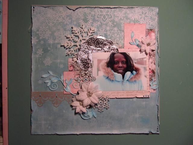Añadí mi foto, flores, troquelado tallos y los copos de nieve. Entonces utilicé la pintura tridimensional en el kit para agregar algunos puntos aquí y allá. También me metí en alguna gasa para darle una sensación de nieve blanda.