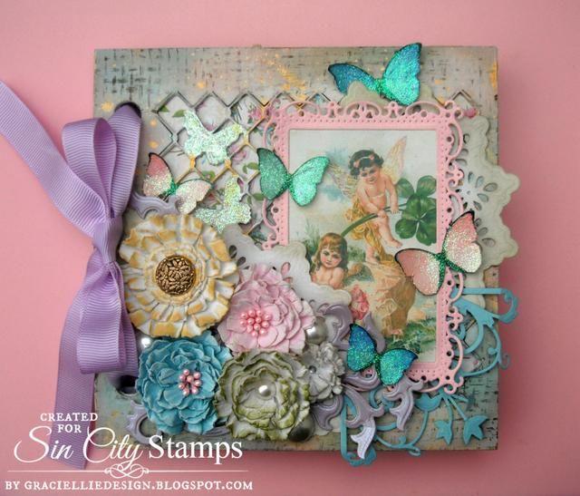 Una vez que todos los elementos estaban listos, empecé a embellecer mi portada con flores hechas a mano, mariposas corte difusos, una imagen de hadas enmarcado y morir recortes.