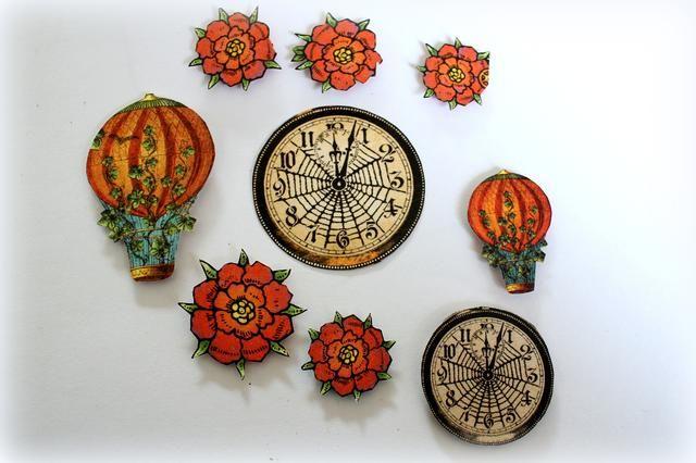 Cortar dos globos de aire caliente, cinco flores y dos relojes de los papeles y añadir foamtape en sus traseros.