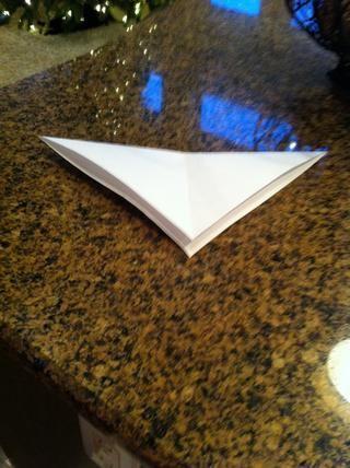 Dobla el papel por la mitad