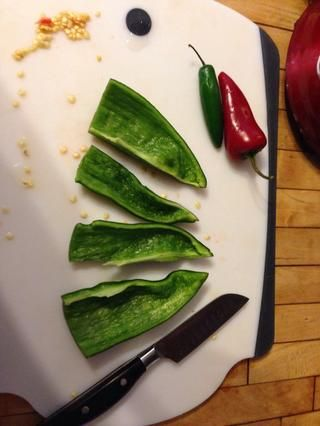 Usted don't need to cut into too many slices. The peppers will be boiled then puréed.