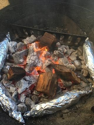Ellos're cooking! Live fire (in this case with hardwood lump charcoal) is a great way to cook - you can use the coal area as well as the grill grate to cook!
