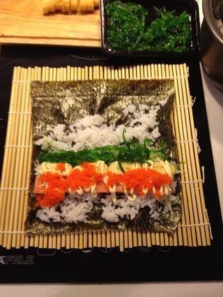 Añadir el arroz y los rellenos.