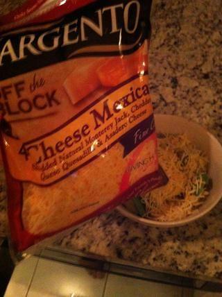 Espolvorear el queso favorito en