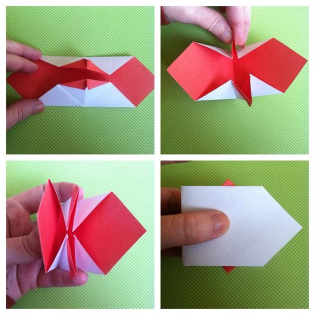 Voltee el papel. Doblar la parte superior y la parte inferior para que're sticking straight up. I could only use one hand, but pinch both & bring them to center. It will close in 1/2. Run hand over it on table to smooth it.