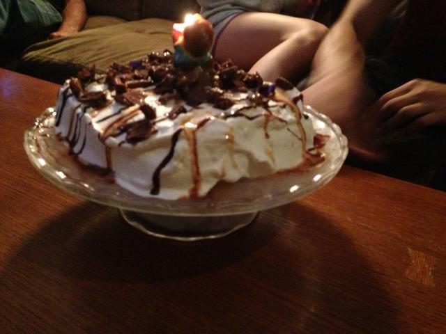 Meter una vela en ella y cantar 18o cumpleaños feliz a tu hermano! :)