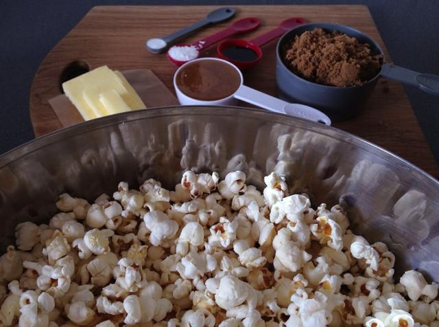 Ah, y don't forget the popcorn! Air popped is better. Pan or microwave popped works diddly do too. Just make sure it's plain. Thank you muchly moo. Divide popcorn between two bowls and set aside.
