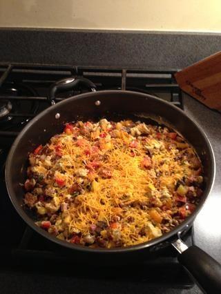Agregar el queso rallado y mezclar