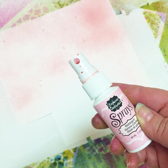 yo quería hacer un papel diferente para cortar corazones de a capa sobre el atc's. so i started by spraying a scrap piece of white cardstock with a light pink spray.