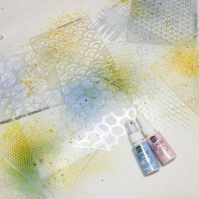 comenzar a rociar documentos utilizando colores más claros de spritzers y aerosoles. comenzar con un fondo base de luz, y luego construir con los colores más oscuros.